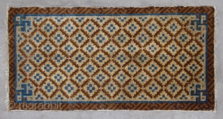 """No.R040 * Chinese Antique Rug .Size: 51x100cm(1'9""""x3'3"""").Origin: Baotou. Age: Early-19th Century.Shape: Rectangle.Background Color: Browns .The field is composed of a very nice flower lattice pattern. The rug was woven in classic brown  ..."""