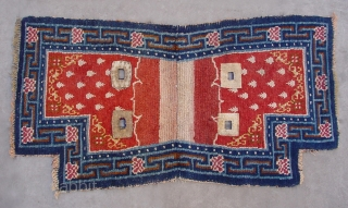 """No.CL038 * Tibetan Antique """"Footprint of the Frog"""" Saddle Rug, Age: Early 19th Century. Size:66 x 119cm (2'2""""x3'11""""). Origin:Tibet. Background Color:Reds. wool/wool."""